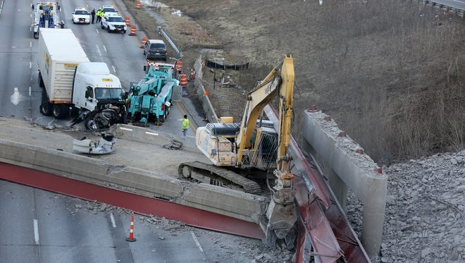 A tractor-trailer is in the process of being removed from the scene of the old Hopple Street overpass collapse.