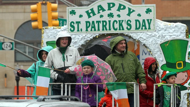 Participants ride a float during the annual Morris County St. Patrick's Day parade in Morristown.