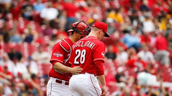 The Reds' Devin Mesoraco talks to pitcher Anthony DeSclafani