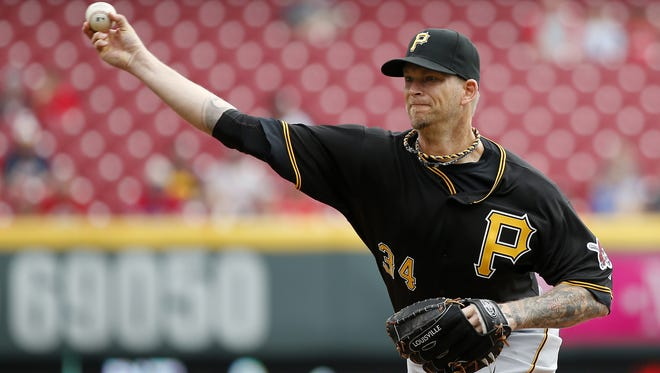 The Pirates' A.J. Burnett delivers against the Reds at GABP on April 9.