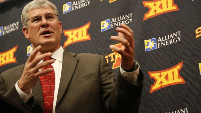 Iowa State football coach Paul Rhoads talks to the media and answers questions during the Iowa State national signing day news conference on Wednesday, Feb. 4, 2015.