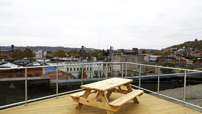 Rhinegeist's new roof deck offers views of the historic Jackson Brewery building, Downtown's central business district and the future streetcar stop on Elm.