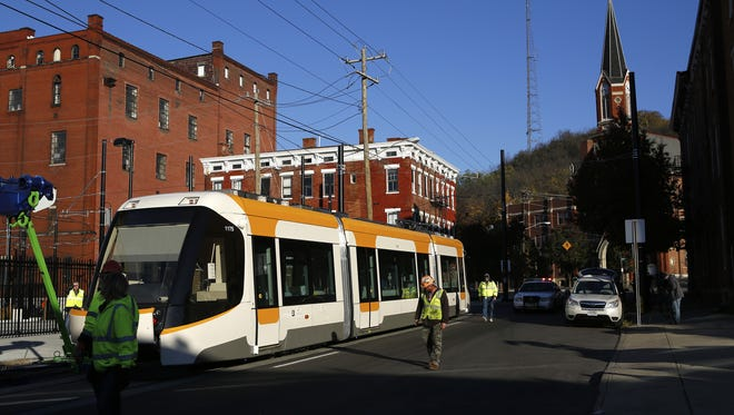 The streetcar makes its first turn onto Race Street from the maintenance garage to be towed along the 3.6-mile route between Over-the-Rhine and The Banks earlier this month.