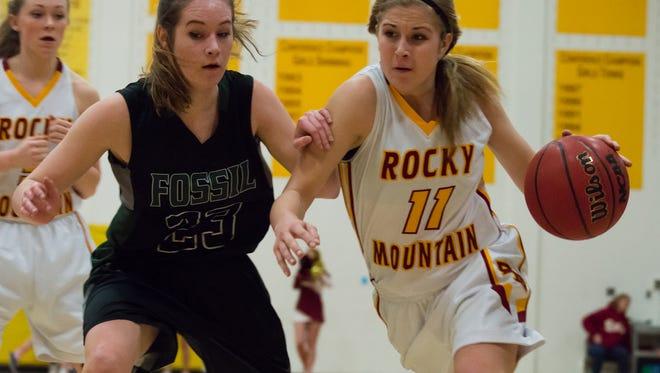 Rocky Mountain High School's Lena Long-shore (11) drives toward the basket against Fossil Ridge High School on February 9th, 2016.