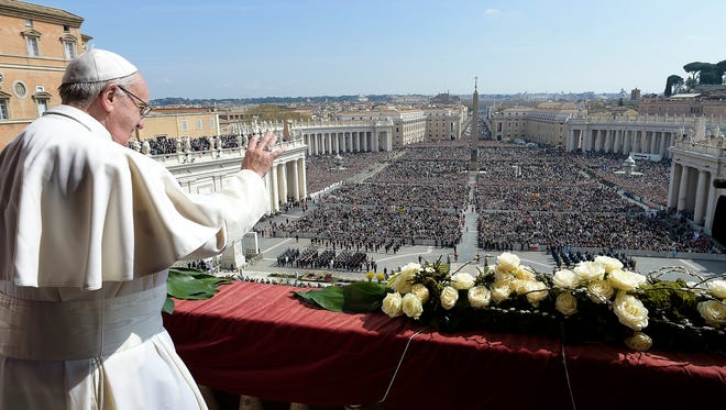 Pope Francis delivers the Urbi et Orbi (to the city and to the world) message at end of the Easter mass, in St. Peter's Square, at the Vatican, March 27, 2016. Pope Francis tempered his Easter Sunday message of Christian hope with a denunciation of  terrorism, recalling victims of attacks in Europe, Africa and elsewhere, as well as expressing dismay that people fleeing war or poverty are being denied welcome as European countries squabble over the refugee crisis.