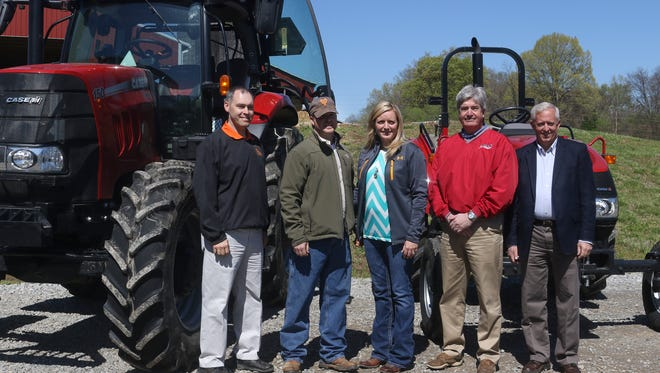 From left, Dan Strasser of the Tennessee Farm Bureau; Jay Head; Tara Jo Head; Tim Hill, territorial sale manager for Case IH; and Tennessee Farm Bureau President Tim Aiken stand in front of Jay Head's tractors that he received for winning the Young Farmers and Ranchers Achievement award at the state level and for being the national runner-up.