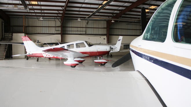 Planes sit in a hangar at Clarksville Regional Airport. The planes are a mix of based corporate and private planes.