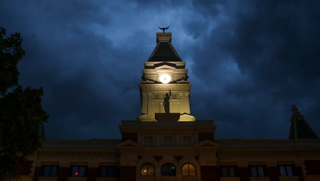 Storm clouds form over the old courthouse in downtown Clarksville on Friday.