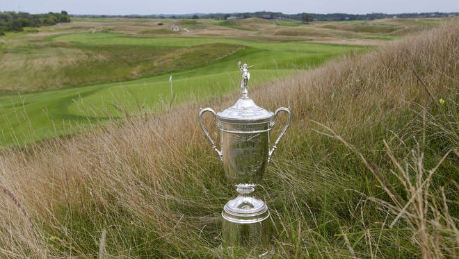 A replica of the U.S. Open trophy sits in the fescue near the 15th hole at Erin Hills, site of the 2017 championship.