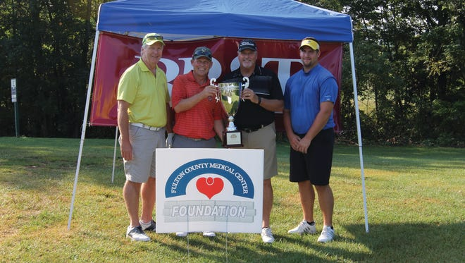 Golfers, left to right, Harold Blubaugh, Larry Crouse, John Blubaugh and Jonathan Blubaugh won the overall FCMC tourney by shooting a 55.