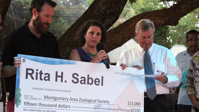 During Zoobilation 2016, Jason Tucker joined his wife, Helene Sabel Tucker, to present a donation to the Montgomery Zoo on behalf of Helene's grandmother, Rita Sabel.  Funds from Mrs. Sabel helped the zoo meet its goal to start construction on a new Stingray exhibit and educational facility. (Contributed)