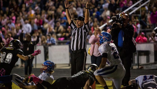 Referees signal a touchdown late in the second quarter after Fairview High School's Beathard dives into the end zone.