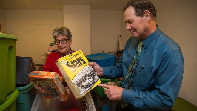 Shop Manager Ilene Miller and Jeff Potter look over two collectible unopened cereal boxes, one of Dan Marino on Wheaties and another of the Toms River Little League team.