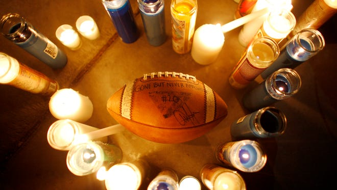 A football that people passed around and signed at a vigil in honor of Richard Nelson on Sunday, Jan. 15, 2017, at Chaparral High School in Las Vegas. Nelson was shot and killed Saturday night in front of his home.