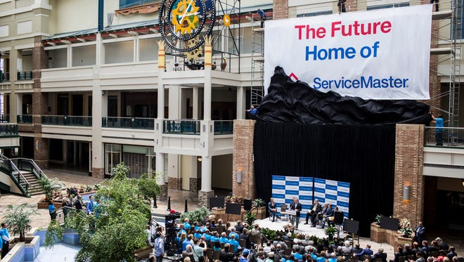 ServiceMaster chief executive Rob Gillette speaks while a large banner is unveiled during a press conference under the lobby's big roof skylight on June 3, 2016. Gilette, a former Honeywell executive, has hired another as his CFO.