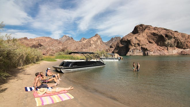 Boaters enjoy a private beach in Topock Gorge.