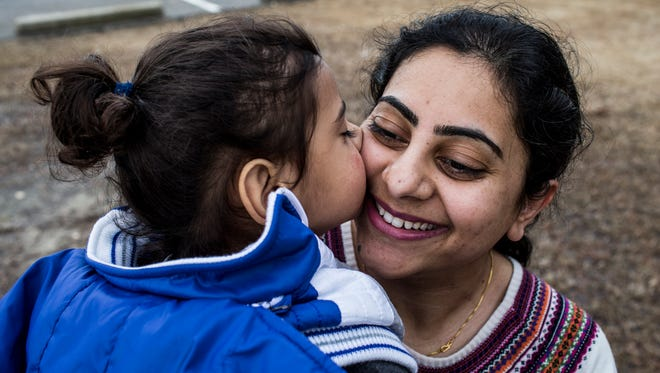 February 28, 2017 - Anhad Singh, two-years-old, kisses his mother, Siminder Kaur, at W.C. Johnson Park in Collierville. Singh had campaigned to bring her son back home from her estranged husband's family in India. Wiith the support of the FBI and local courts, the two-year-old boy has been transported from India and returned to his mother in Collierville. Anhad Singh was brought back last week from northern India by the parents of her estranged husband and reunited with his mother in the Memphis airport.