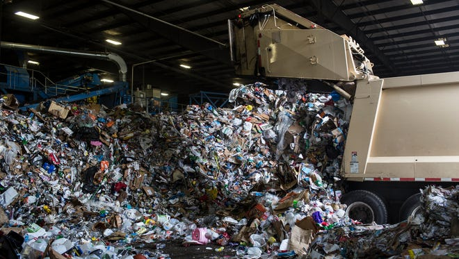 April 21, 2017 - A City of Memphis truck dumps its load of recyclables at the ReCommunity recycling facility off of Farrisview.