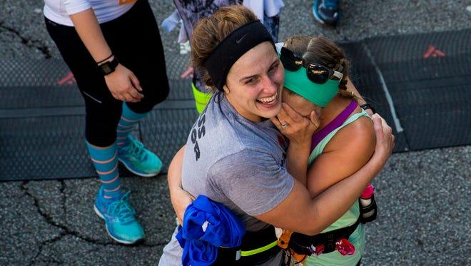 Half marathon runners cross the Finish Swine at the 19th annual Flying Pig Marathon Sunday, May 7, 2017 in Cincinnati.
