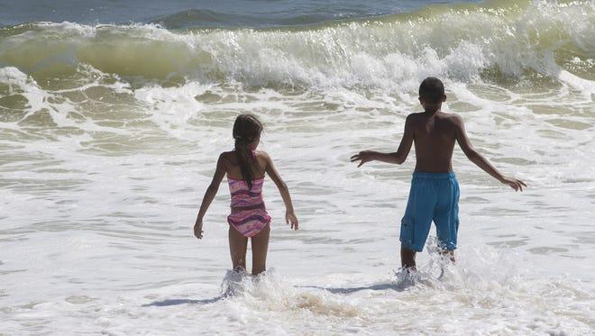 Kids play near the shoreline in Brick.
