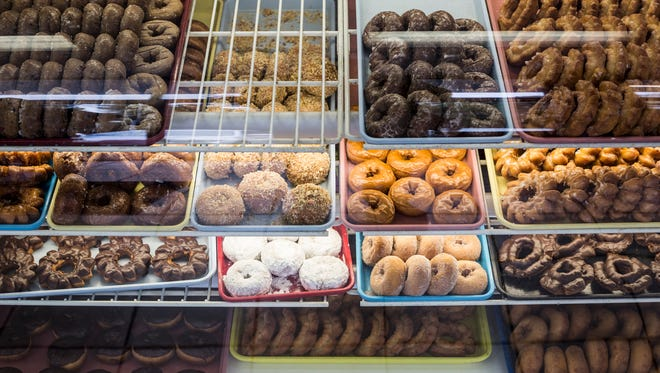 A wide variety of doughnuts are seen behind the glass May 24, 2017, at Gibson's Donuts at 760 Mount Moriah Road. National Doughnut Day is Friday, June 2.
