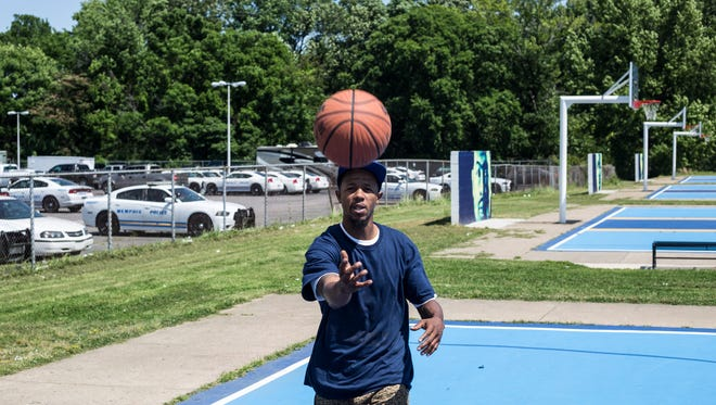 "May 26, 2017 - Taurean ""T-Head"" Moy rebounds the ball while mentoring a young basketball player at Halle Park. Moy once scored 83 points in a high school game and became a Memphis basketball legend. Now, there's a documentary on his life."