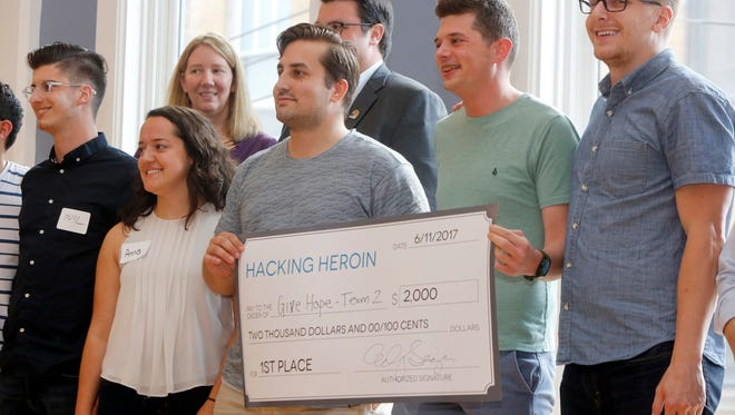 The Giving Hope team won the Hacking Heroin event at Union Hall Sunday. They designed a crowdfunding website for agencies fighting the heroin epidemic.
