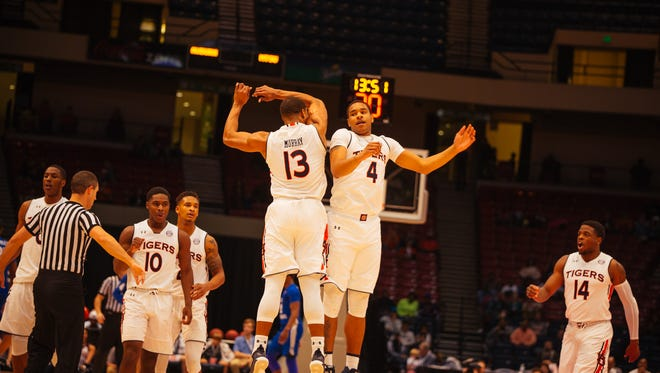 Auburn players celebrate 76-70 victory over Middle Tennessee State in Legacy Arena at BJCC in Birmingham on Dec. 16, 2017.