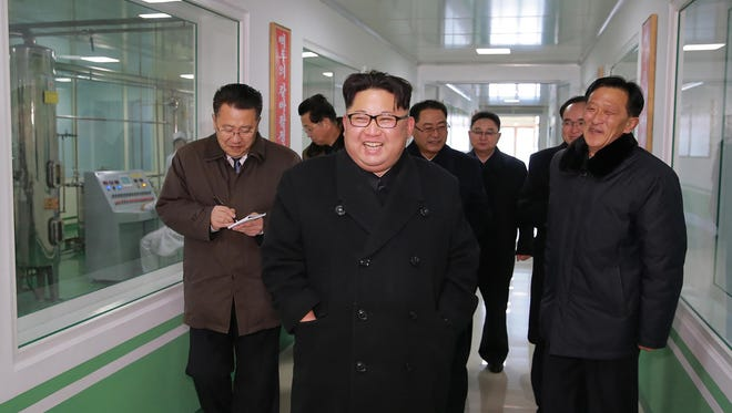 This undated picture released on Jan. 25, 2018 by North Korea's official Korean Central News Agency (KCNA) shows North Korean leader Kim Jong-Un (C) visiting the Pyongyang Pharmaceutical Factory.