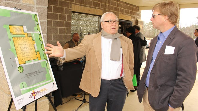 Don King, left, and Andy Stewart examine a map showing future plans at the Rural Health Medical Program site in Selma on Friday. Alvin Benn/Special to the Advertiser