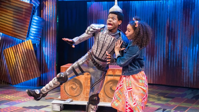 """Darrington Clark (Tin Man) gets a hand from Reese Parish in First Stage's """"The Wiz,"""" on stage at the Marcus Center's Todd Wehr Theater."""