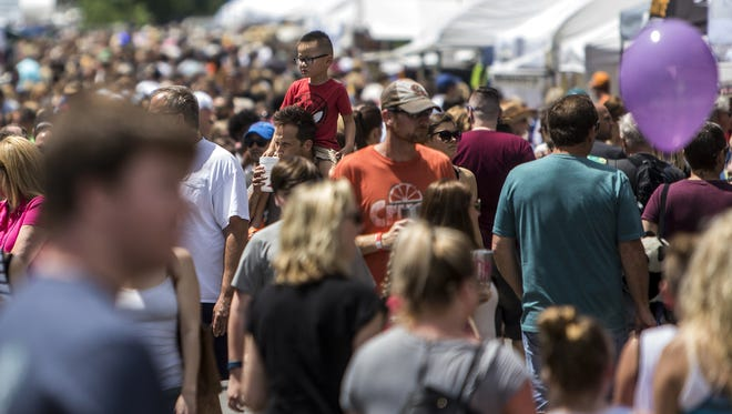 Visitors take in the atmosphere of the 34th Main Street Festival in Franklin. A new sidewalk will help with festival flow and daily pedestrian traffic into downtown Franklin.