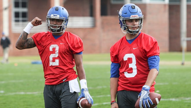 Quarterbacks David Moore, left, and Brady White during the Tigers' first practice of spring in March.