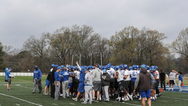 March 17, 2018 - The Memphis Tigers huddle up before the start of the Tigers' first practice to start of their 2018 season.