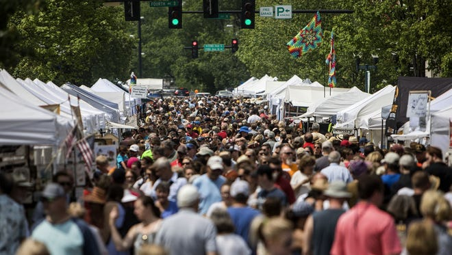 Visitors take in the atmosphere of the 34th Main Street Festival in Franklin in 2017.