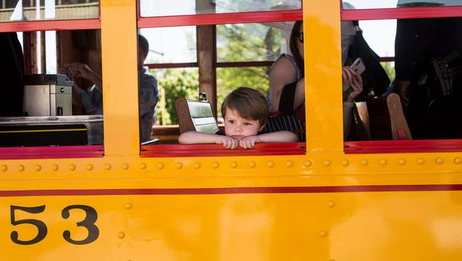 April 30, 2018 - Wyatt Roberts, 3, watches out the window of the first Trolley to run with passengers in nearly four years during the grand re-opening ceremony for the Main Street Trolley.