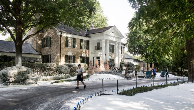 """Crews worked to transform the grounds around the mansion at Graceland into a winter wonderland for the filming of the Hallmark Channel's new movie, """"Christmas at Graceland,"""" on July 19. Elvis Presley Enterprises filed another lawsuit against the city of Memphis this week as it pursues approval of its expansion plans."""