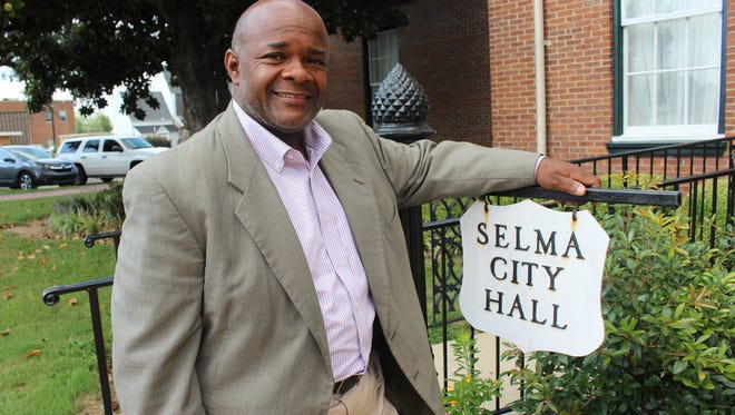 Future Dallas County Probate Judge Jimmy Nunn admires the Selma City Hall sign on Broad Street. Alvin Benn/Special to the Advertiser