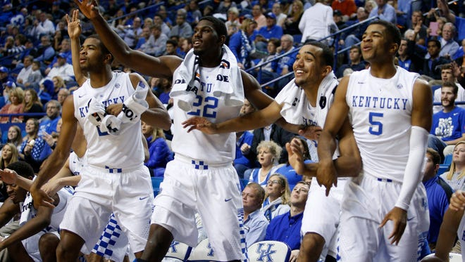 Kentucky's bench erupts after a bench player scores during the 121-52 win over Georgetown.The University of Kentucky Men's Basketball team hosted Georgetown College, Sunday, Nov. 09, 2014 at Rupp Arena in Lexington. Photo by Jonathan Palmer, Special to the CJ