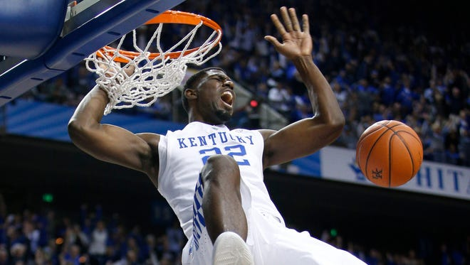 Kentucky forward Alex Poythress jams an alley-oop in the second half. After this dunk UK went on a 16-2 run, and won the game The University of Kentucky Men's Basketball team hosted Buffalo, Sunday, Nov. 16, 2014 at Rupp Arena in Lexington. Photo by Jonathan Palmer, Special to the CJ