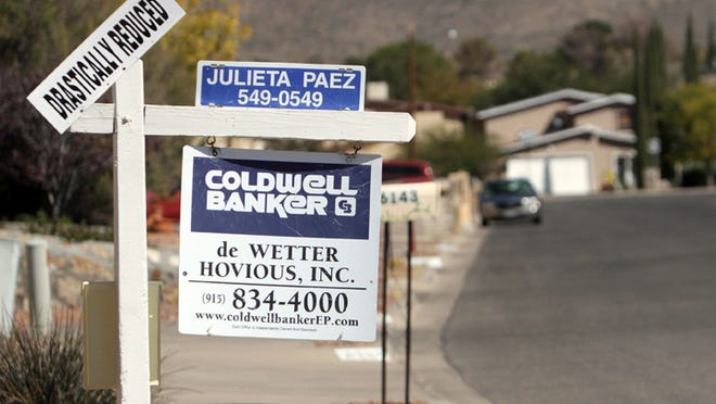 """A home for sale has a sign reading """"Drastically Reduced"""" in west El Paso Thursday. Mark Lambie/El Paso Times"""