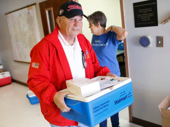 Meals on Wheels volunteer Charlie Stevens picks up