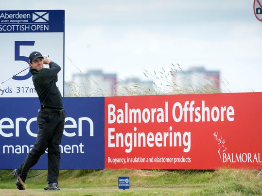 Rory McIlroy  tees off at the 5th during day one of the Scottish Open at Royal Aberdeen golf course, Aberdeen Scotland Thursday July 10, 2014. (AP Photo/Kenny Smith/PA) UNITED KINGDOM OUT