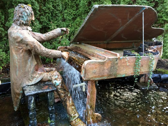 The Piano Fountain sculpture is found by the lodge at Belknap Hot Springs.