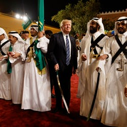 Royal welcome for Trump in Saudi Arabia as troubles mount at home