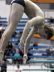 Fox Lane's Reid Gerken performs a dive at the NY State