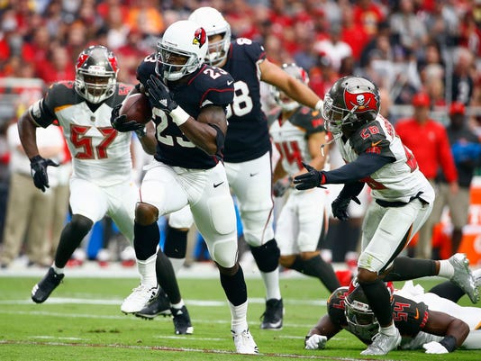 Arizona Cardinals running back Adrian Peterson (23) runs for a touchdown as he gets past Tampa Bay Buccaneers cornerback Vernon Hargreaves (28) during the first half of an NFL football game, Sunday, Oct. 15, 2017, in Glendale, Ariz. (AP Photo/Ralph Freso)