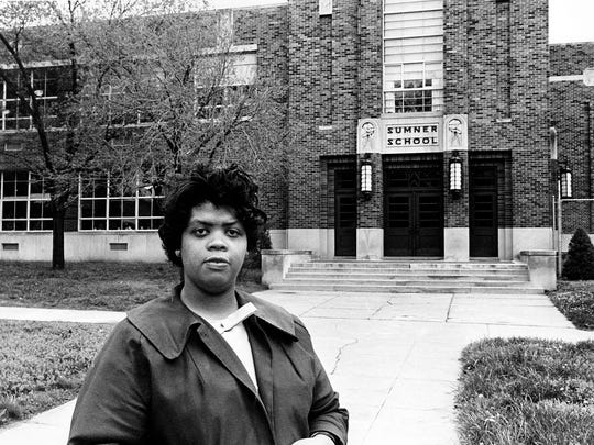 Linda Smith, the former Linda Brown, stands in front of the Sumner School in Topeka, Kan., on May 8, 1964. The refusal of the public school to admit Brown in 1951, then age 9, because she is black led to the Brown v. Board of Education court case.