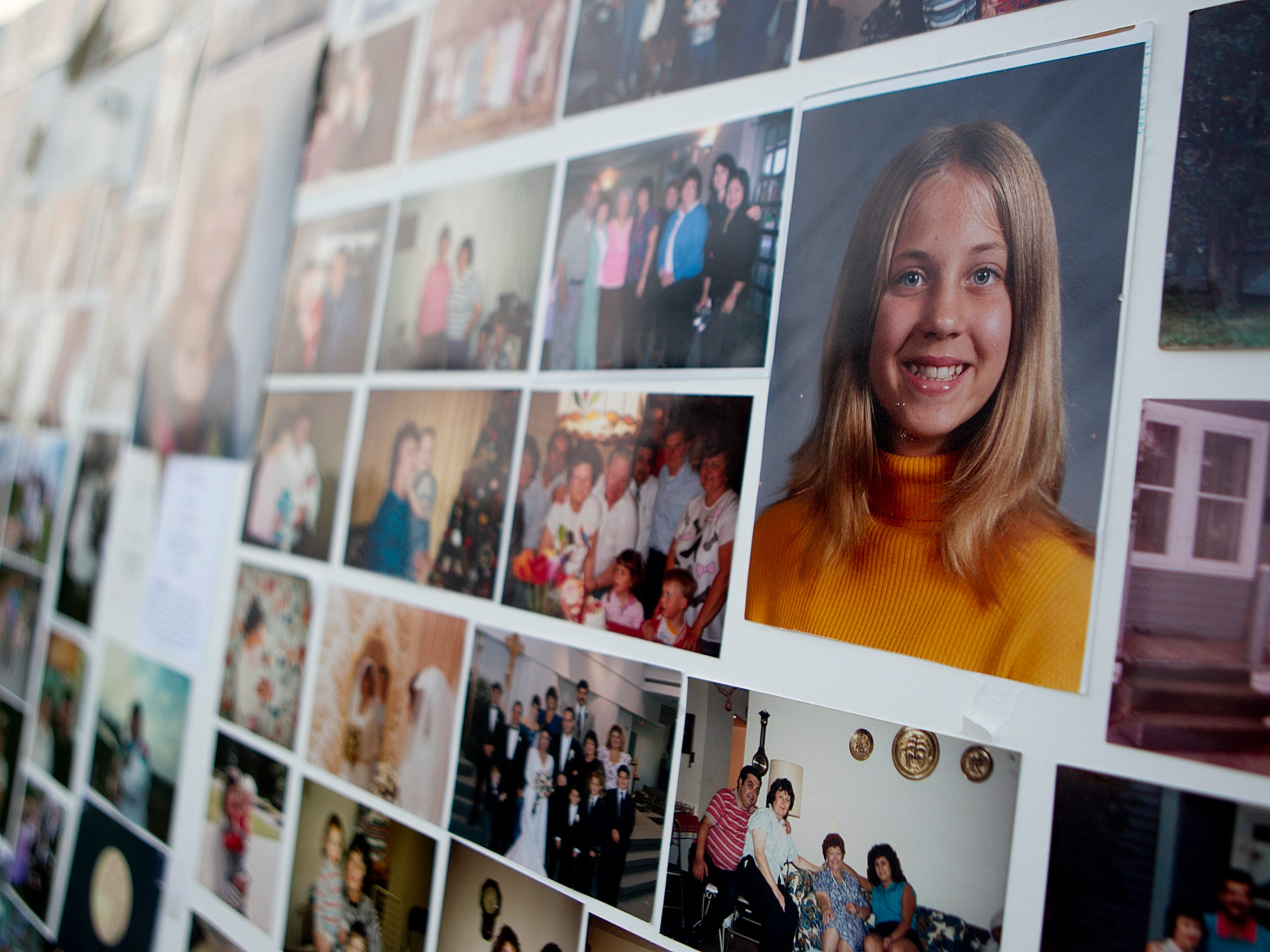 Photos of Gabrielle Campo are pinned up to poster board for her memorial service on Aug. 29 in Wausau.