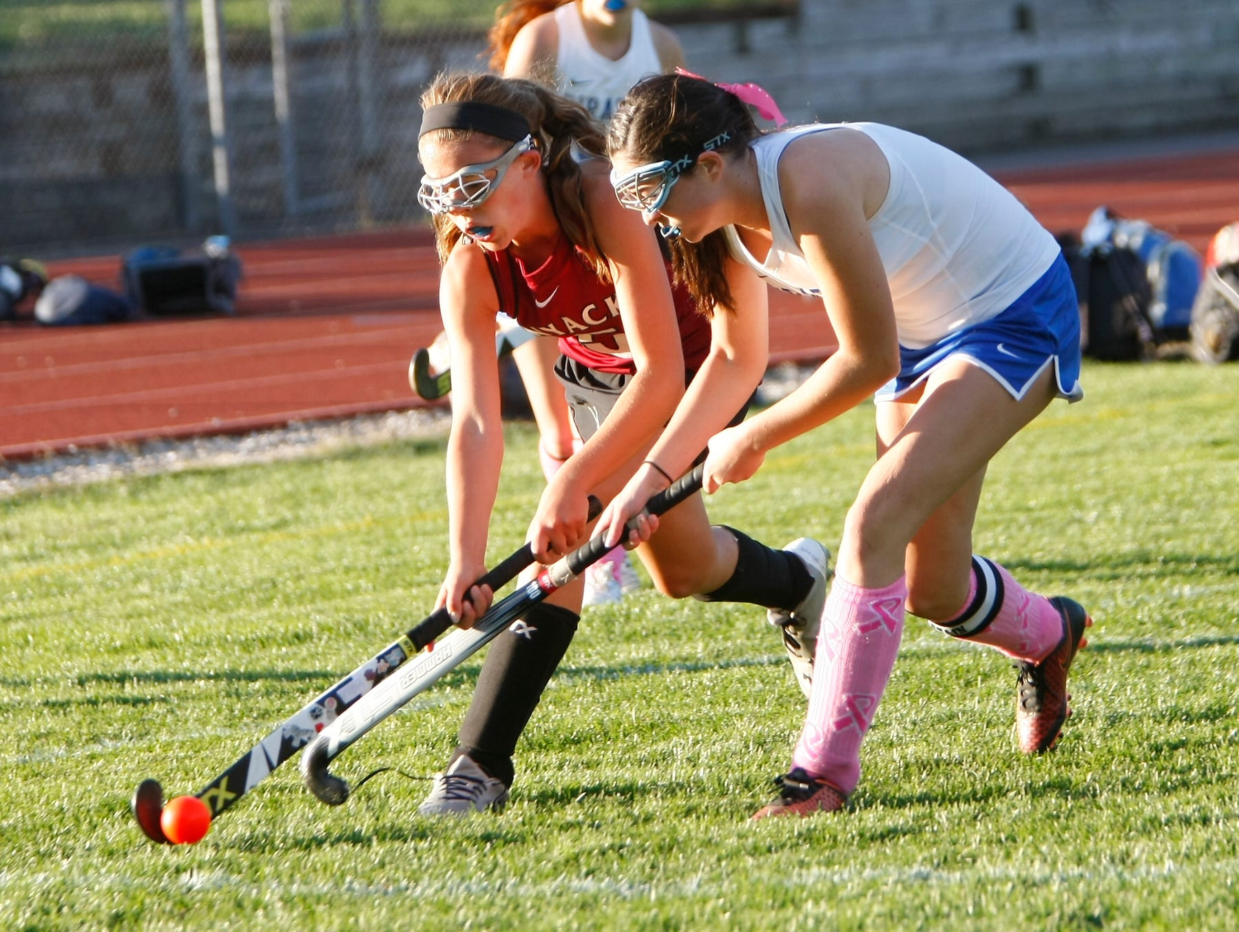 Nyack's Emily Connelly (5), left, and Pearl River's Kelly York (3) battle for possession during a varsity field hockey game at Pearl River High School on Friday, Oct. 16, 2015.